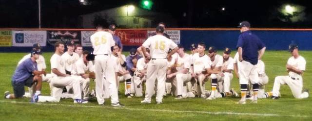 Chad Clinger | Galion Inquirer The Galion Graders take a knee as the coaches speak with the squad following a 5-3 loss to the Lorain County Ironmen on Wednesday July 5.
