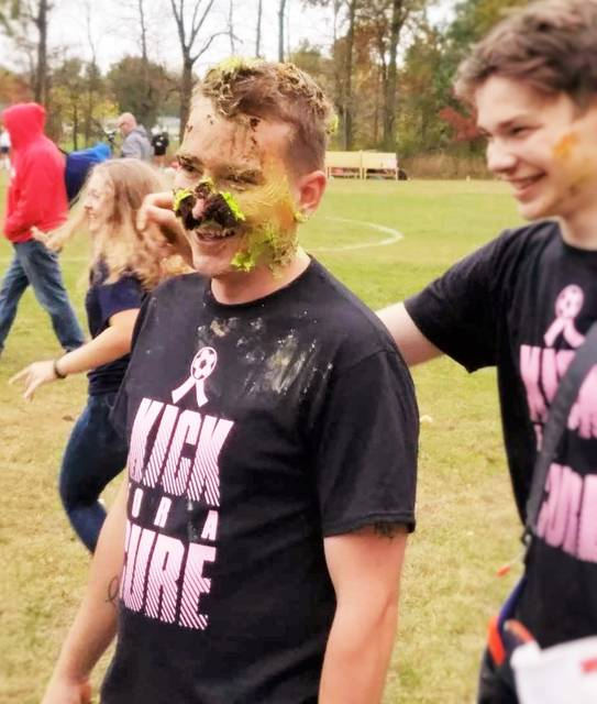 Chad Clinger   Galion Inquirer Galion head coach Eric Palmer was greeted with a cupcake attack after his Lady Tigers defeated the River Valley Lady Vikings on Thursday in the Kick For A Cure game.