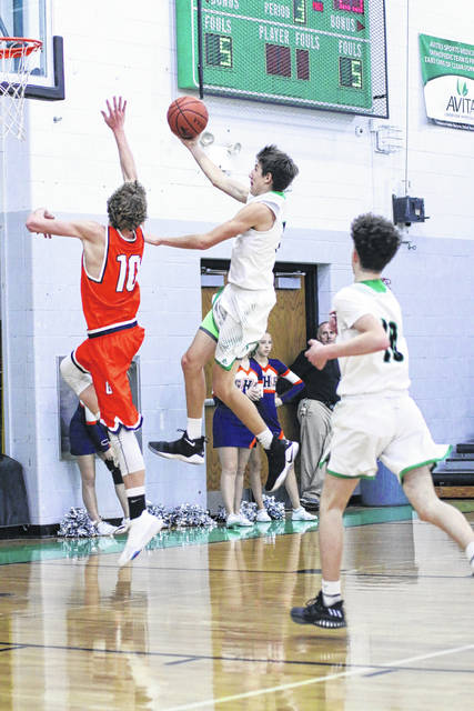 Clear Fork's AJ Blubaugh goes up for the layup against the Tigers Gage Lackey during their Thursday night MOAC clash in Bellville. The Colts remain undefeated in the conference, defeating Galion; 67-47.