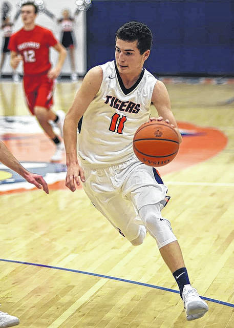 Don Tudor | Galion Inquirer Galion junior Jack McElligott looks to drive the ball into the lane during home boys basketball action on Friday. McElligott was the top Tigers scorer with 15 points as Galion opened the season with a 67-50 victory over the visiting Bucyrus Redmen.