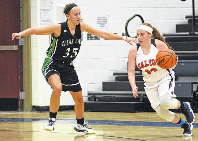 Don Tudor | Galion Inquirer Galion's Kelsey Hoffman looks to drive on Clear Fork's Allison Studenmund during MOAC girls basketball action last Friday night. Hoffman finished with seven points but the Lady Colts earned the victory; 41-34.