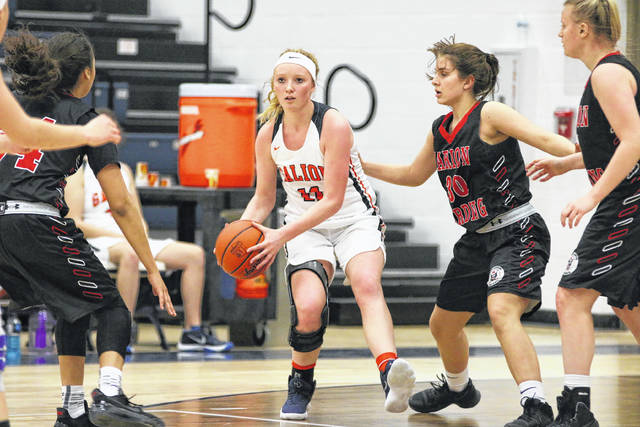 Erin Miller | Galion Inquirer Galion's Gracie Groves looks to dish out of heavy defensive traffic during Friday's home game against Harding. Groves led the Lady Tigers in scoring with 11 points but the Prexies came away with the 55-31 MOAC win.