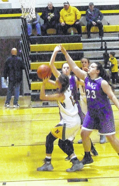 Brooke Bennett works inside for a lay-up attempt in her team's win over MG Saturday afternoon.