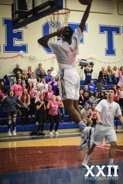 Photo courtesy of Shelley West Clark, XXII Photography Crestline's Davon Triplett goes in for the fancy flush during Saturday's non-conference clash with the visiting Vanlue Wildcats. Triplett recorded 27 points and 22 rebounds for the double-double in the Bulldogs 58-51 victory.