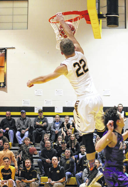 Erin Miller | Galion Inquirer Northmor's Brock Pletcher throws down a one-handed slam Friday evening in the Knights game against conference rival, the Mount Gilead Indians. The Golden Knights remain undefeated in the KMAC after defeating the Indians; 67-45.