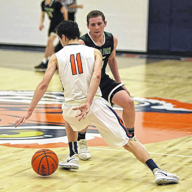 Don Tudor | Galion Inquirer Galion's Jack McElligott uses some fancy ball handling to elude his Clear Fork defender during Thursday evening's contest between the hosting Tigers and the visiting Colts.