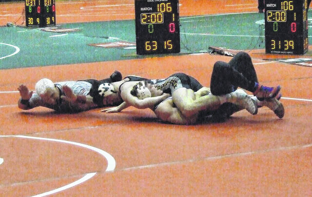 Conor Becker is shown pinning his opponent from Tuslaw on Sunday.