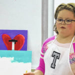 Galion third-grader Teagan Prince gives her classmates an art lesson