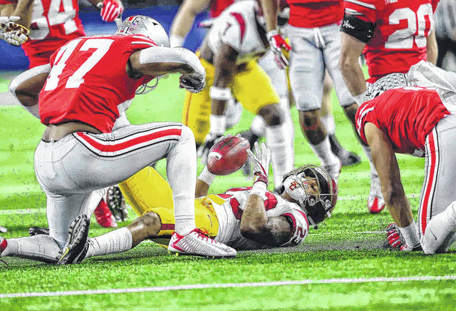 Ohio State #47 linebacker Justin Hilliard (left) celebrates along with Ohio State #11 wide reciever Austin Mack as they make a big tackle on the kicoff return of USC #23 WR Velus Jones Jr.   during the 82nd Goodyear Cotton Bowl Classic at AT&T Stadium December 29th, 2017 Photos by Don Speck