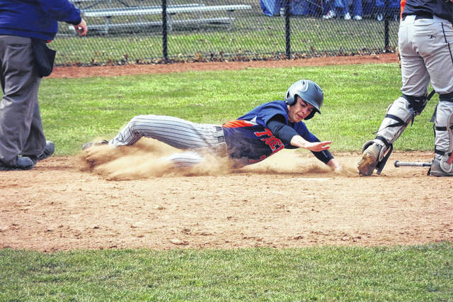 Erin Miller   Galion Inquirer The Galion Tigers had themselves an offensive explosion on Saturday during a non-conference doubleheader with the Seneca East Tigers. In the two games, Galion put up a total of 30 runs and Mitch Dyer, pictured sliding into home, scored two of them.