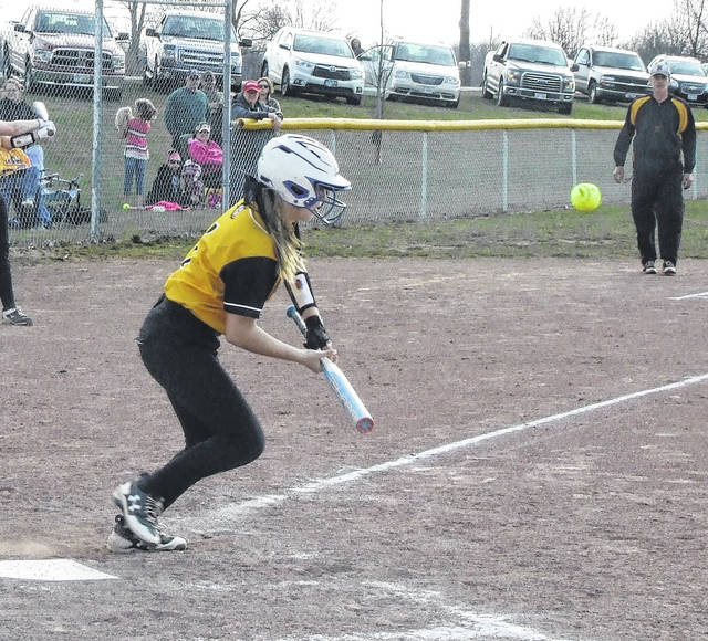 Northmor's Maddie Hoverland tries to slap down a hit against East Knox in her team's 10-6 win Thursday.