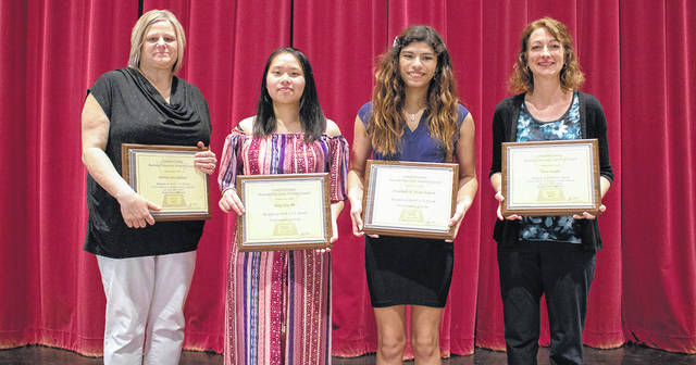 Courtesy photo Bucyrus Secondary School teachers Mrs. Brenda Stockmaster (far left) and Mrs. Terra Hamm (far right) spoke on behalf of Bucyrus BEST Award recipients junior Bing Jing He (second from left) and senior Annabella Flores-Eidson (second from right) during the annual Crawford County BEST Awards ceremony on May 2