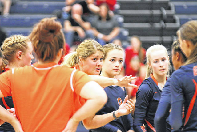 Galion Head Volleyball Coach Jaime Valentine directs her team during a time out in play Thursday night when the Tigers rallied to beat Marion Pleasant in their first MOAC match up of the season.